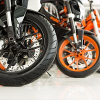 Riders-will-love.-Cropped-shot-of-the-wheels-of-motorbikes-standing-in-the-line-at-the-motorcycle-salon